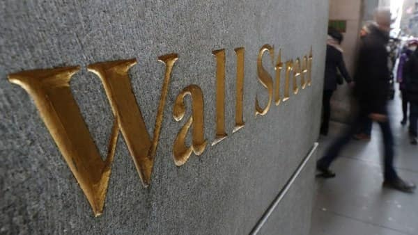 FILE PHOTO: A street sign, Wall Street, is seen outside the New York Stock Exchange in New York City. (Reuters)