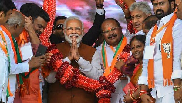 Guntur: Prime Minister Narendra Modi being garlanded at a BJP rally in Guntur.  (PTI)