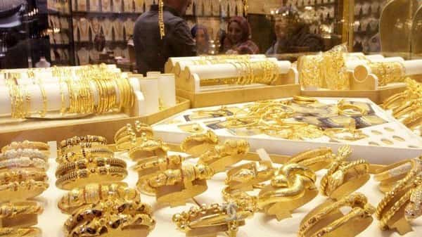 Gold jewellery is seen displayed for sale at a shop.  (Reuters)