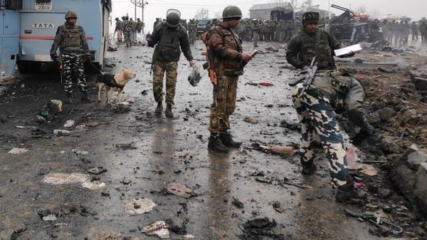 Indian soldiers examine the debris after the terror attack in Pulwama on Thursday. (Photo: Reuters)