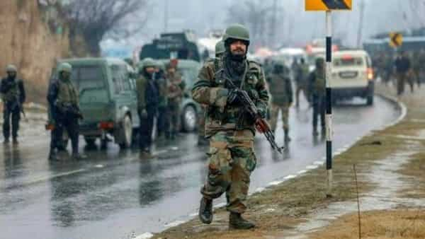 Army soldiers near the site of suicide bomb attack at Awantipora in Pulwama district of Jammu and Kashmir.  (S. Irfan/PTI)