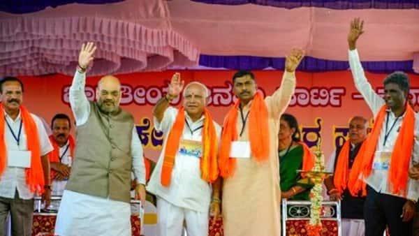 BJP chief Amit Shah, B.S. Yeddyurappa and others in Chikkaballapur on Thursday. (PTI)