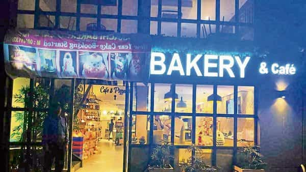 A Piece Of Cloth Masks Half The Signboard Karachi Bakery Outlet In Bengaluru