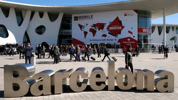 People walk next to the Mobile World Congress banner in Barcelona  (Reuters)