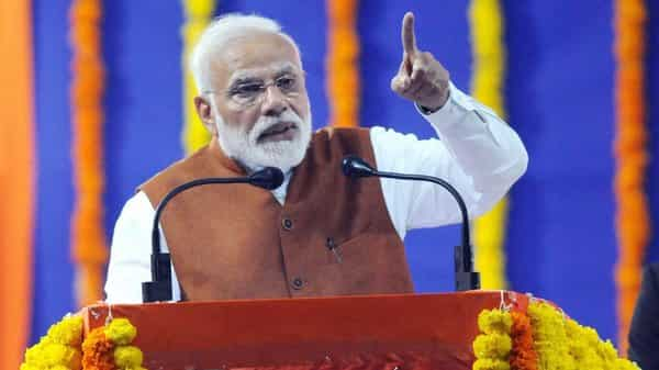 'There is no role of middleman in this scheme,' Modi said. Photo: PTI