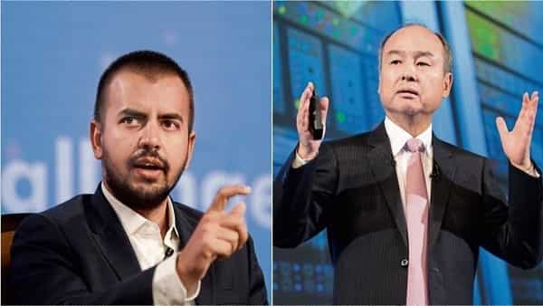 Ola founder Bhavish Aggarwal and SoftBank chairman Masayoshi Son. (Bloomberg)