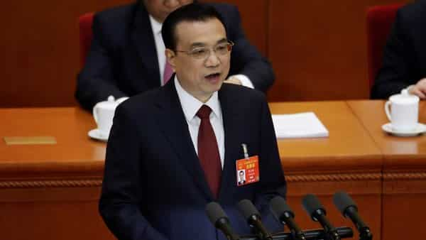 Chinese Premier Li Keqiang delivers the work report at the opening session of the National People's Congress (NPC) at the Great Hall of the People in Beijing, China on Tuesday. (ANI/Reuters Photo)