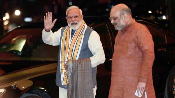 Prime Minister Narendra Modi being welcomed by BJP National President Amit Shah as he arrives to attend the BJP Central Election Committee (CEC) meeting.  (PTI )