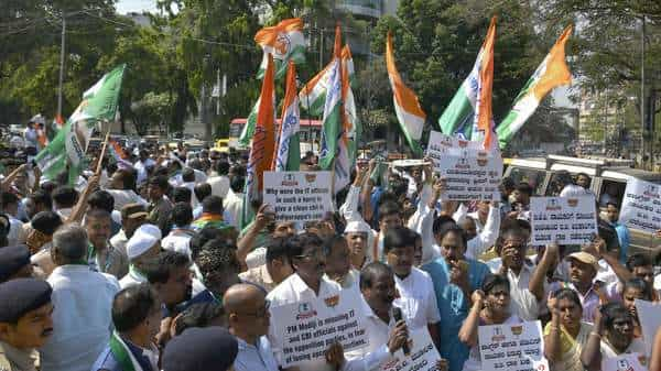 Congress and JD(S) workers protest against the income tax raids, in Bangalore on Thursday. (AFP)