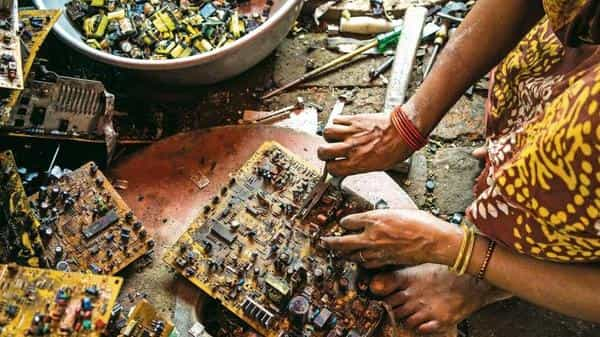 A motherboard being dismantled in Sangrampur, West Bengal.