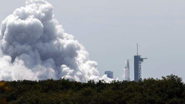 A SpaceX Falcon Heavy rocket is test fired at the Kennedy Space Center in Cape Canaveral, Florida, U.S. on 5 April 2019.  (Reuters)