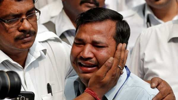 An employee of Jet Airways is consoled by his colleague during a protest demanding to 'save Jet Airways' in New Delhi. Photo: Reuters