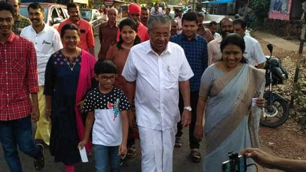 Kerala chief minister Pinarayi Vijayan standing in a queue to vote for general elections in the state. All 20 seats in Kerala will be decided on Tuesday, in the third phase of polling. Photo credit: Special arrangement