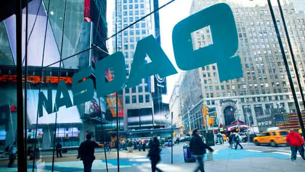 Nasdaq hits record high at open on strong tech earnings; 3M weighs on Dow