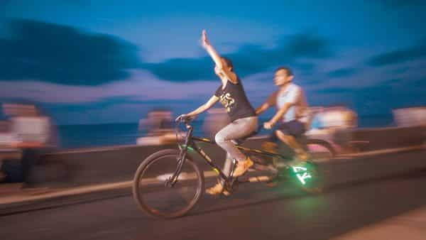 Combining midnight cycling with storytelling in Mumbai.