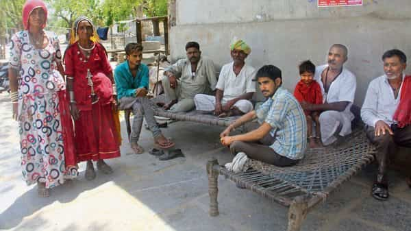 Mukesh Gadhilo, 24, (in checked shirt) is a graduate but works as a blacksmith with his father as he hasn't found another job. (Photo: Lakhan Sharma/Mint)