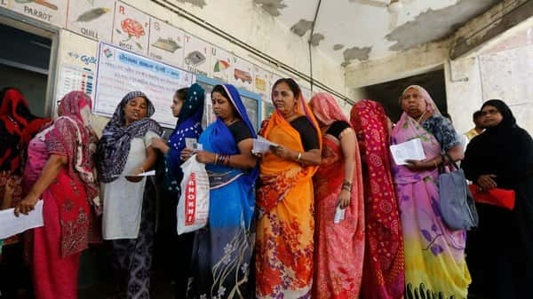 Indian women stand in queue to cast their vote for general election in Ahmadabad on April 23, 2019.  (AP)