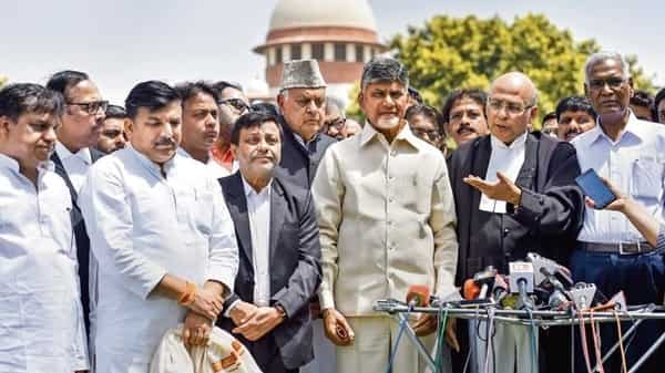 Opposition leaders outside the Supreme Court in New Delhi, Tuesday. (PTI)
