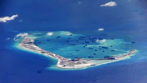 FILE PHOTO - Chinese dredging vessels are purportedly seen in the waters around Mischief Reef in the disputed Spratly Islands in the South China Sea in this still image from video taken by a P-8A Poseidon surveillance aircraft provided by the United States Navy May 21, 2015. To match Special Report CHINA-ARMY/ROCKETS     U.S. Navy/Handout via Reuters/File Photo  ATTENTION EDITORS - THIS IMAGE WAS PROVIDED BY A THIRD PARTY. EDITORIAL USE ONLY. THIS PICTURE WAS PROCESSED BY REUTERS TO ENHANCE QUALITY. AN UNPROCESSED VERSION IS AVAILABLE IN OUR ARCHIVE