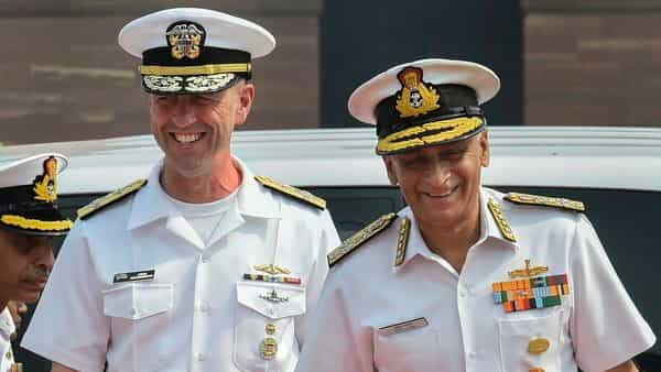 Indian Navy chief Admiral Sunil Lanba (R) with his US Navy counterpart John Michael Richardson, during guard of honour in New Delhi, Monday. (PTI)