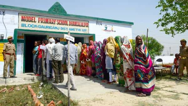 Voters queue at a polling station to cast their ballots during the fifth phase of the general election in Amethi, Uttar Pradesh (AFP file)
