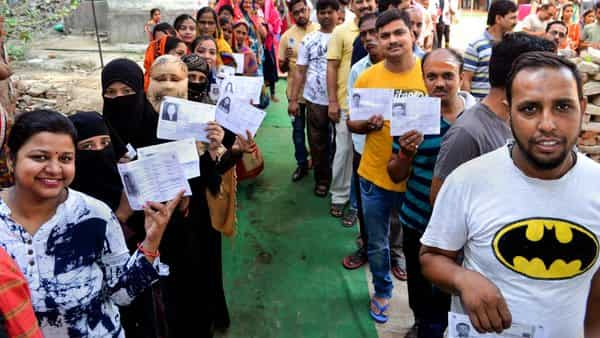 Varanasi: Voters wait in queues to cast their votes at a polling station, during the seventh phase of Lok Sabha elections, in Varanasi