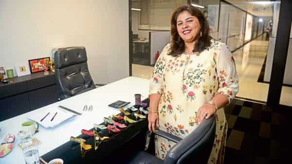 Farah Malik Bhanji, CEO of Metro Brands, at her office with her collection of miniature shoes (Photo: Abhijit Bhatlekar/Mint)