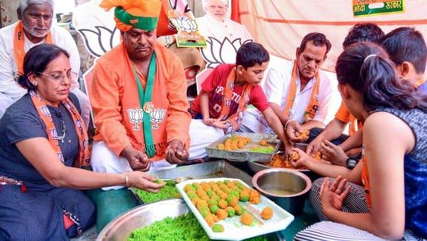 BJP workers prepare laddus.  (AFP)