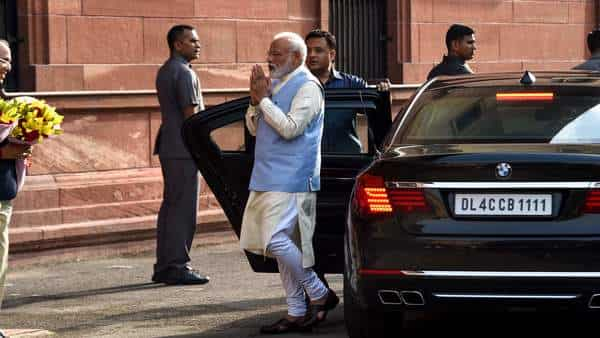 Prime Minister Narendra Modi gestures as he arrives to attend a meeting with his newly-named cabinet in New Delhi (Photo: AFP)