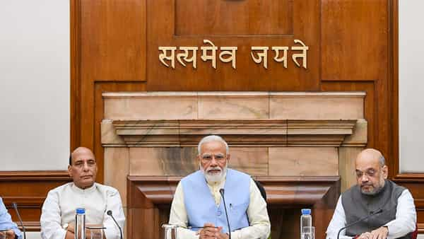 Prime Minister Narendra Modi with Union Ministers Rajnath Singh and Amit Shah during the first cabinet meeting, at the Prime Minister's Office, in South Block, New Delhi (Photo: PTI)