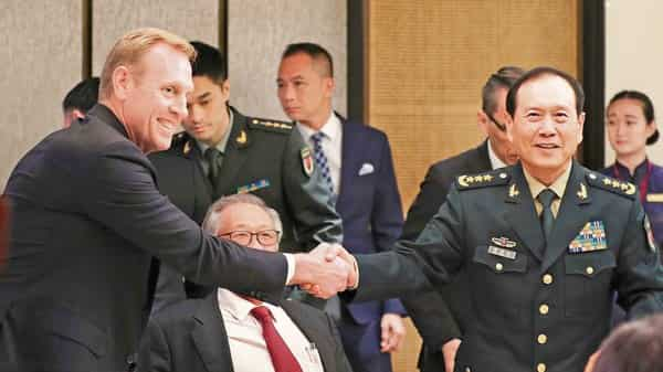 Acting US defence secretary Patrick M. Shanahan (left) with Chinese defence minister Wei Fenghe at the IISS Shangri-la Dialogue in Singapore.1 (Photo: AP)