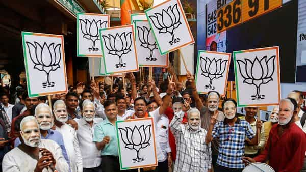 BJP supporters celebrate the party's lead during the counting of votes for Lok Sabha elections 2019, at BJP office in Thane. (Photo: PTI )