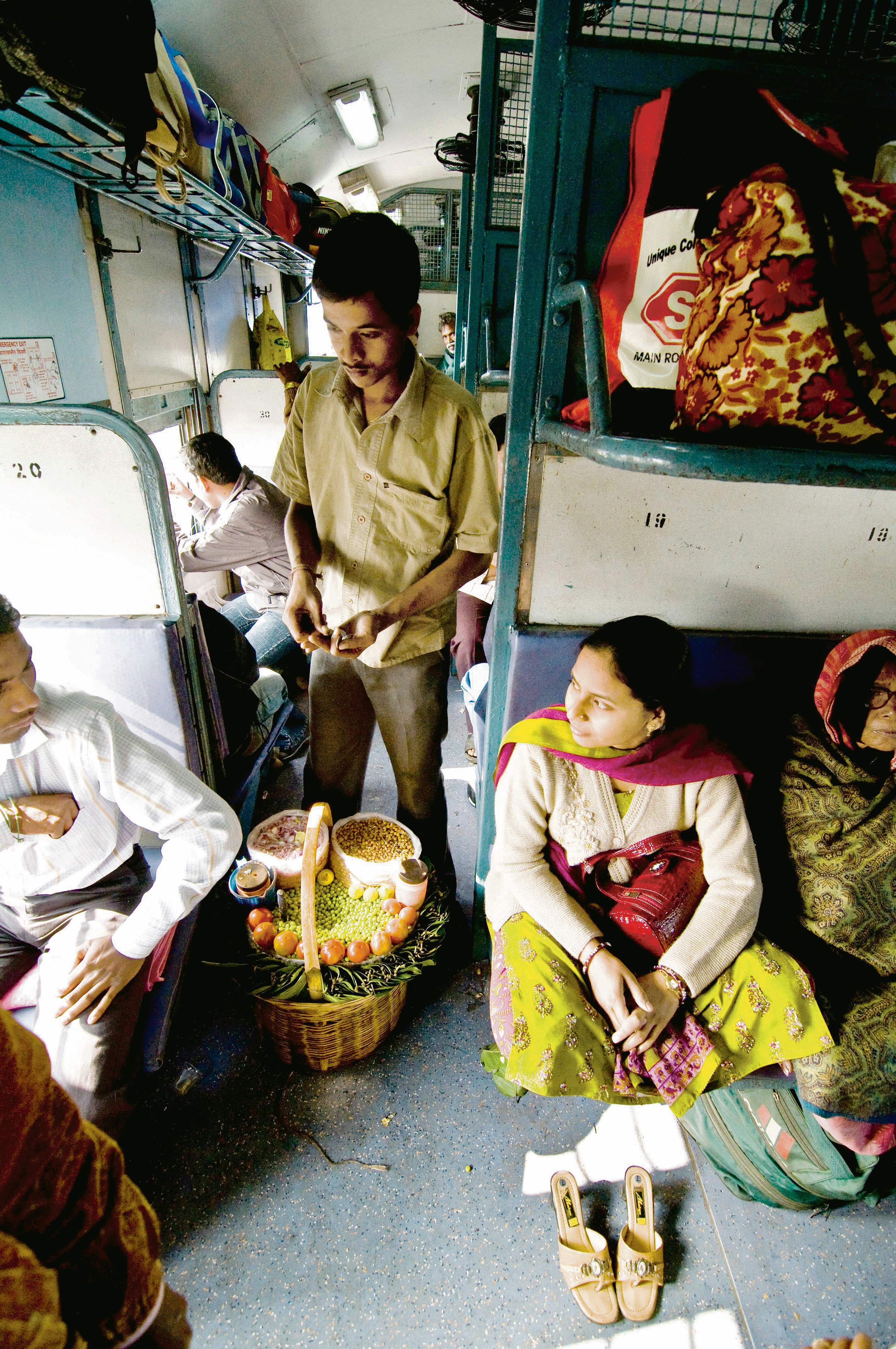 A vendor selling snacks on a train in Odisha. Photo: Alamy