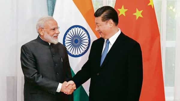 PM Narendra Modi with Chinese President Xi Jinping at the SCO summit in Bishkek on Thursday. (PTI)