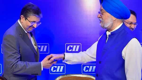 Civil aviation minister Hardeep Singh Puri meets Managing Director of Kotak Mahindra Bank Uday Kotak during the Confederation of Indian Industry (CII) National Council Meeting in New Delhi (Photo: PTI)