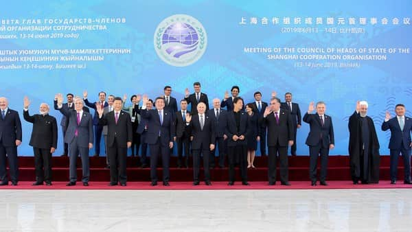 Indian Prime Minister Narendra Modi and Iranian President Hassan Rouhani are seen waving to the media while they pose for a family photo during the Shanghai Cooperation Organization summit in Bishkek, Kyrgyzstan  (Photo: Iranian Presidency Office via AP)