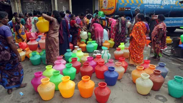 People wait to fill vessels filled with drinking water from a water tanker in Chennai (Photo: AP)