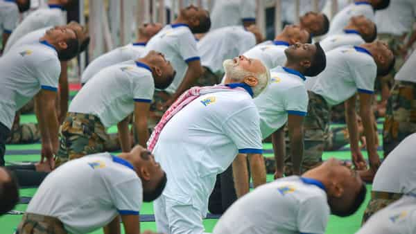Prime Minister Narendra Modi performs yoga during a mass yoga event on the 5th International Day of Yoga at Prabhat Tara ground, in Ranchi, on Friday. (PTI)