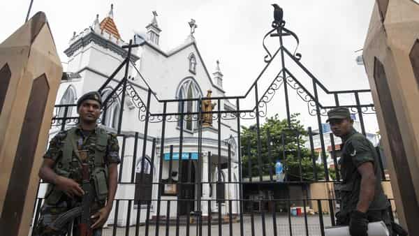 Sri Lankan soldiers stand guard outside a closed church in Colombo on April 28, 2019, a week after a series of bomb blasts