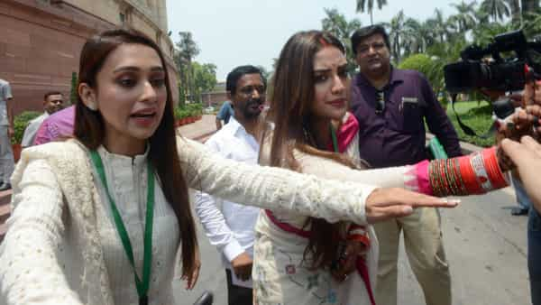 Actress and TMC MPs Nusrat Jahan and Mimi Chakraborty at Parliament House during the Budget Session in New Delhi.  (ANI )
