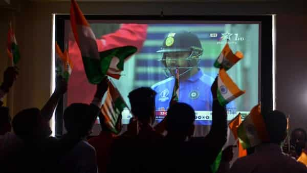 Cricket fans react as they watch a live broadcast of the Cricket World Cup match between India and Pakistan. (AFP )