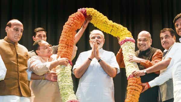 Narendra Modi is felicitated by BJP leaders at a parliamentary party meeting (Photo: PTI)