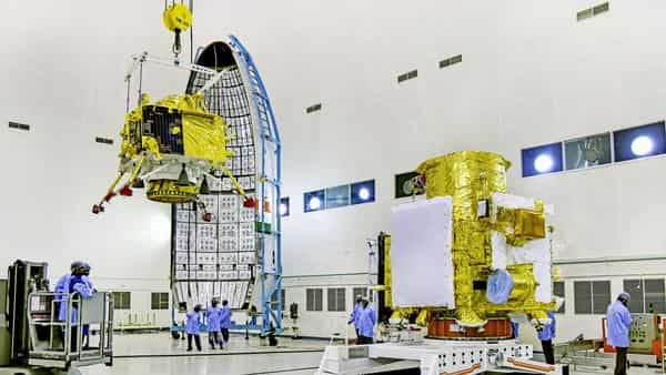 In this picture released by ISRO Thursday, July 11, 2019, officials carry out the hoisting of the Vikram Lander during the integration of Chandrayaan-2, at the launch center in Sriharikota.  (Photo: ISRO/PTI)