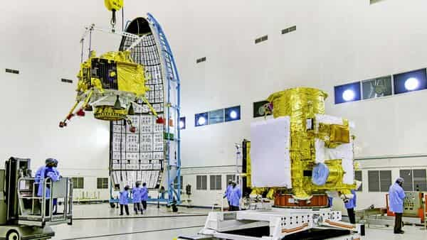 In this picture released by Isro, officials carry out the hoisting of the Vikram Lander during the integration of Chandrayaan-2, at the launch centre in Sriharikota