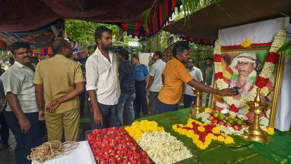 Chennai: Family members and employees offer tributes to the portrait of the P Rajagopal, founder of Hotel Saravana Bhavan chain of hotels, after he passed away due to a heart attack in Chennai. (PTI )