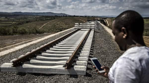 Incomplete rail tracks for the Standard Gauge Railway (SGR) line lay on the ground near Duka Moja, Kenya, on Thursday, May 9, 2019. China is now the single largest financier for infrastructure in Africa, funding one-in-five projects and constructing every third one, according to a Deloitte report.  (Bloomberg)