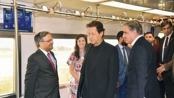 Pakistan PM Imran Khan with foreign minister Shah Mahmood Qureshi (right) and other officials, in Washington DC.