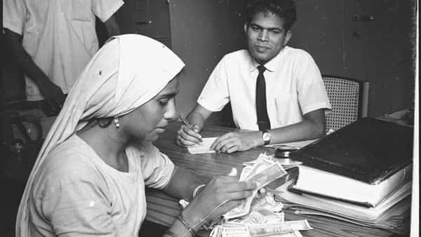 A file photo of a woman at a Syndicate Bank branch, three months after the lender was nationalized in 1969.