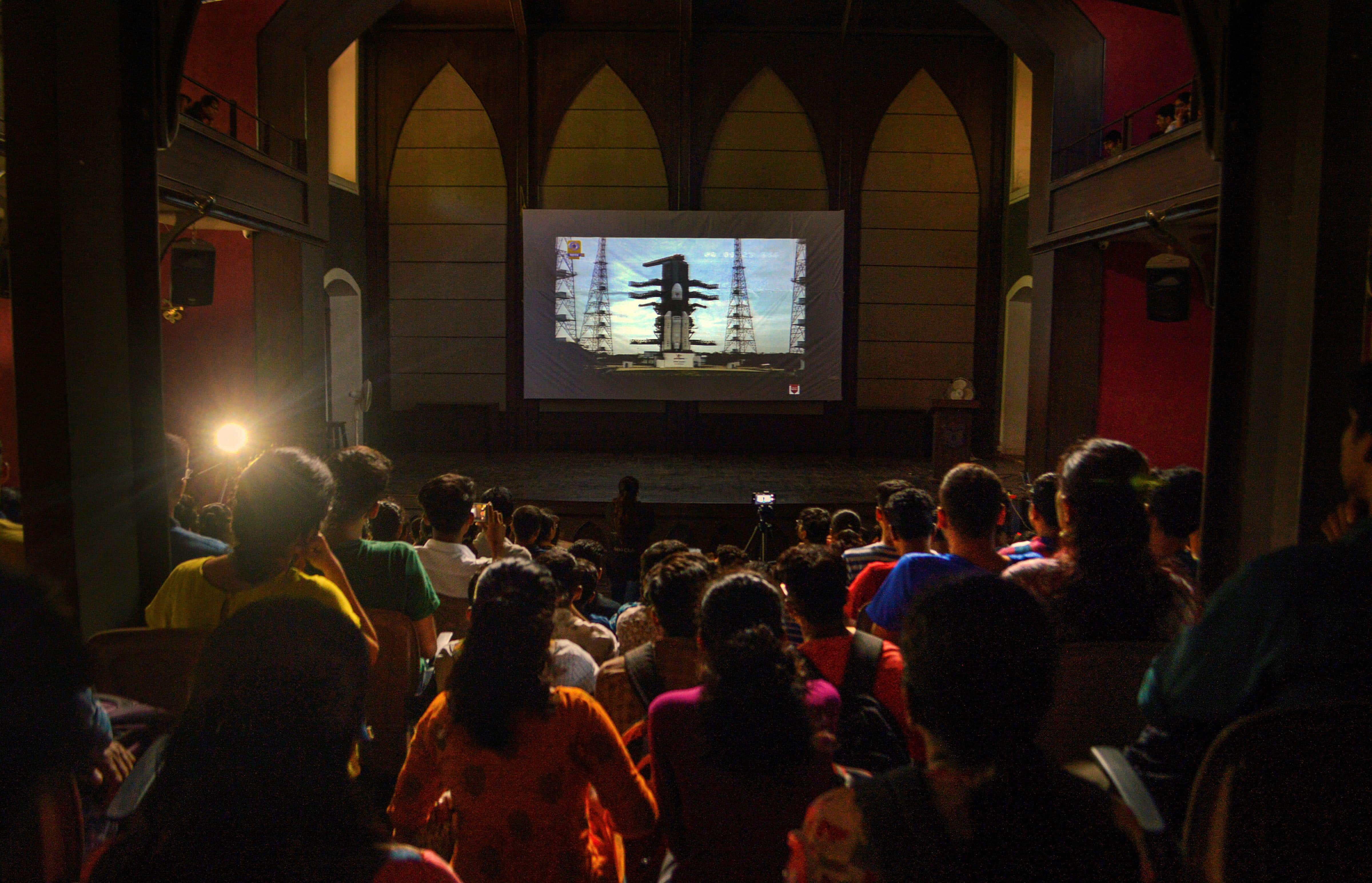 Pune: Fergusson College students watch the live telecast of ISRO's Chandrayaan-2 launch, in Pune, Monday. (PTI)
