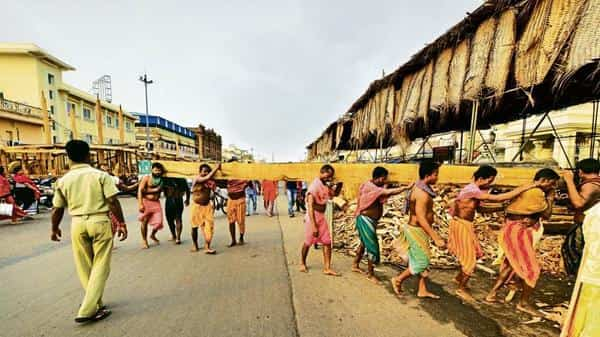 Logs being moved for the construction of the 'raths' ahead of the Jagannath Rath Yatra in Puri. (Photo: Aniruddha Chowdhury/Mint)